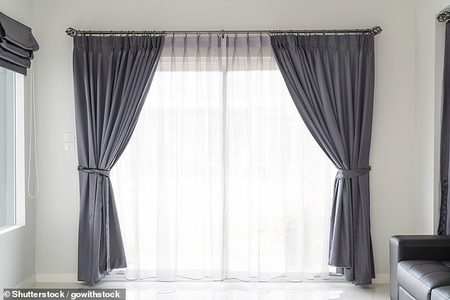 Hanging curtains as high as possible will make your ceilling look higher and your room bigger, Deirdre said (stock picture)