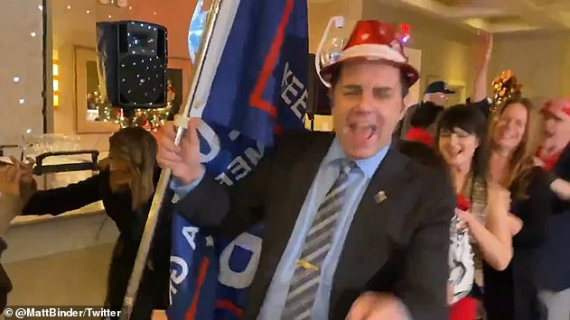 Footage from the Whitestone Republican Club's festivity - held in Queens on December 9 - showed maskless members forming a conga line and dancing to the Bee Gees