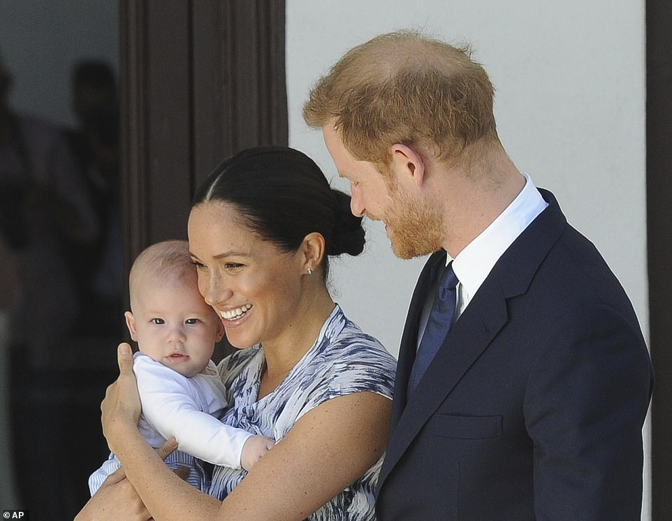 The Duke and Duchess of Sussex are pictured with their son Archie while visiting Cape Town in September 2019