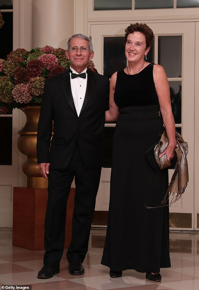 Master of surprises: Dr Anthony Fauci (left) said his wife of 35 years, Christine Grady (right), on Sunday threw him a surprise party on Zoom to celebrate his 80th birthday (pictured above arriving at a state dinner at the White House in October 2016)