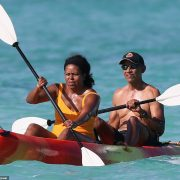 Barack and Michelle warm up for the holidays in Hawaii with couple's kayak outing