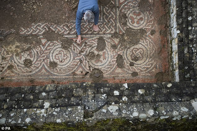 Britain's first 5th century mosaic is uncovered at Roman villa in Gloucestershire