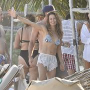 Brooke Burke showcases her toned tummy in a bikini while on holiday in Mexico with Scott Rigsby