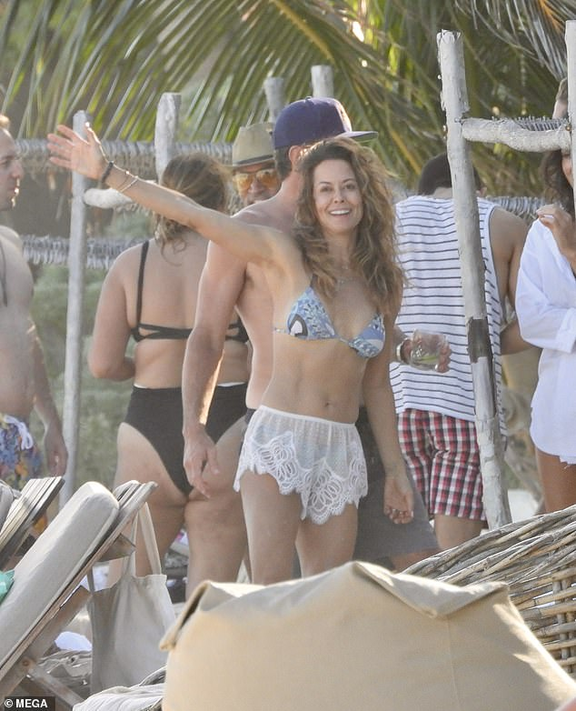 Sun seeker: Brooke Burke was reeling in full moon vibes as she struck a pose while on holiday in Mexico with her boyfriend, Scott Rigsby