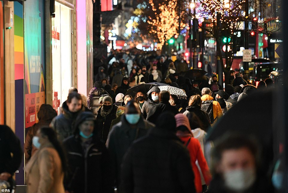 Christmas shoppers swamp high streets after they were left with just EIGHT HOURS to buy their gifts