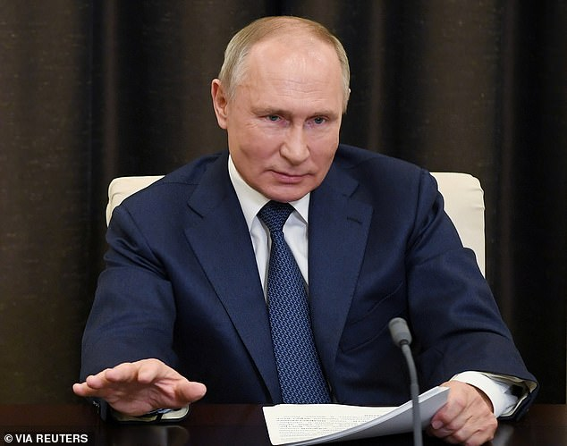 Vladimir Putin (pictured) doesn't want you to take the Covid vaccine. 'We've been tracking the anti-vaxxer propaganda, and a lot of it is linked to his bot-farm in St Petersburg,' a Minister told me