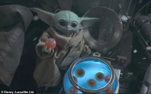 Fan favourite: The character popularly known as Baby Yoda in a scene from The Mandalorian, which is getting two new spinoff shows in Disney's barrage of streaming announcements