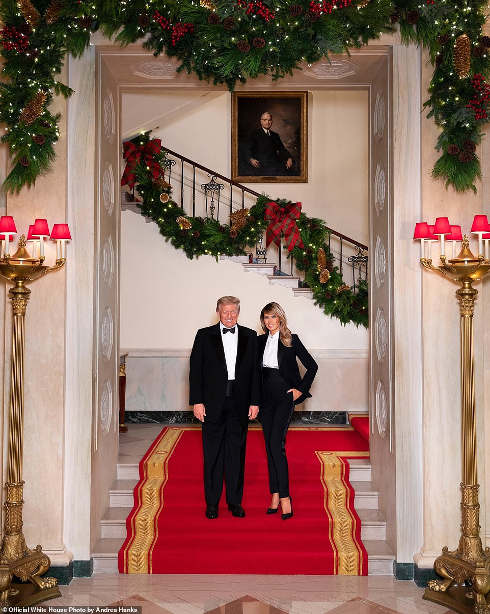 Donald and Melania Trump pose in matching tuxedoes for Christmas portrait