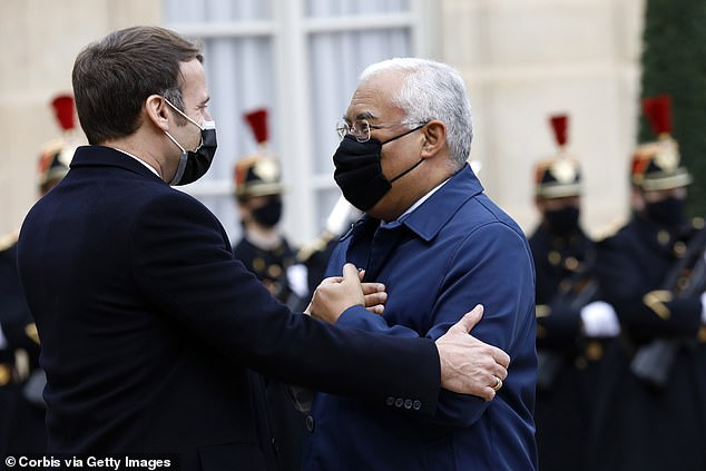 Emmanuel Macron tests positive for Covid-19 and is self-isolating day after hugging Portugal's PM