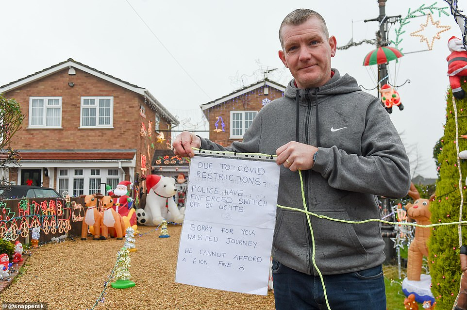 Officers say Trevor Payne's (pictured) full-blown festive lights - which he puts up each year to raise money for mental health charities - are drawing 'large gatherings' outside his home in Staffordshire