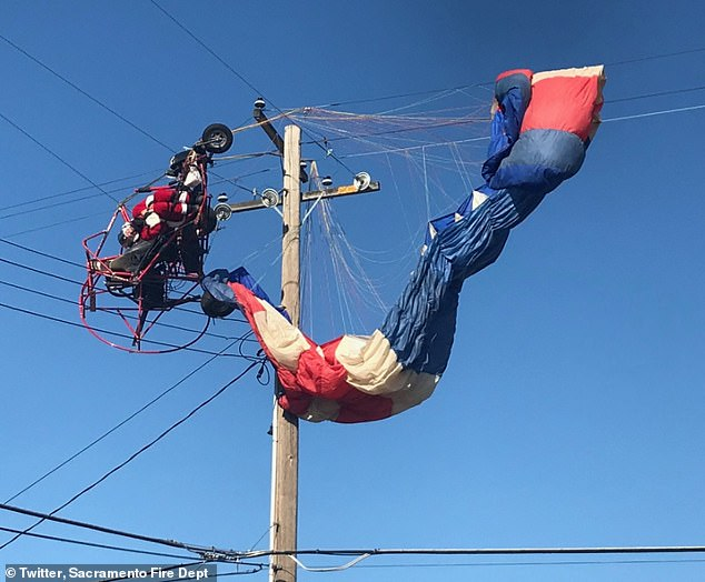 Flying 'Santa' CRASHES into power lines before being rescued by firefighters