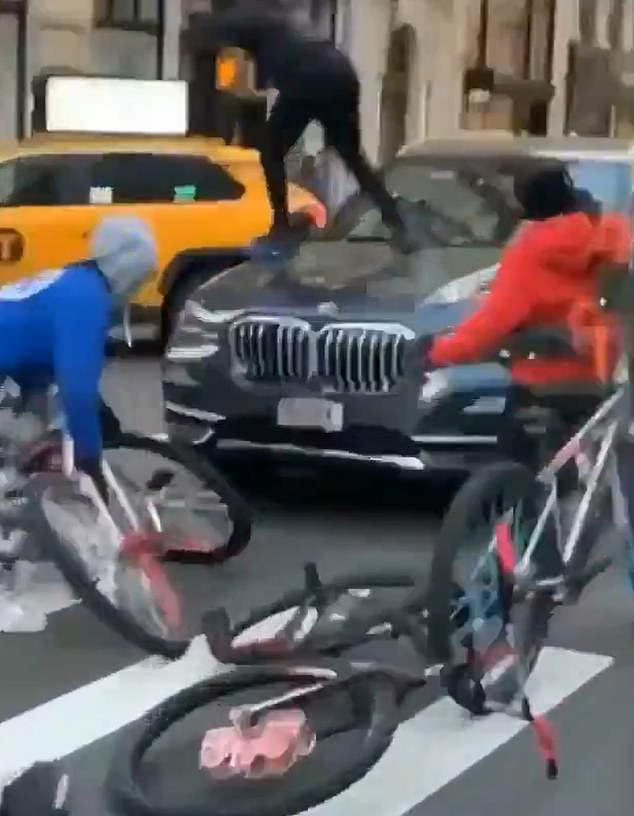 Gang of 50 teens smash up SUV in brazen daylight attack on New York's Fifth Avenue