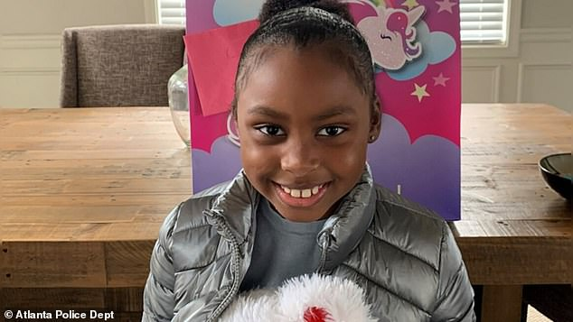 Girl, 7, dies days after being shot in the back of the head while Christmas shopping with her family