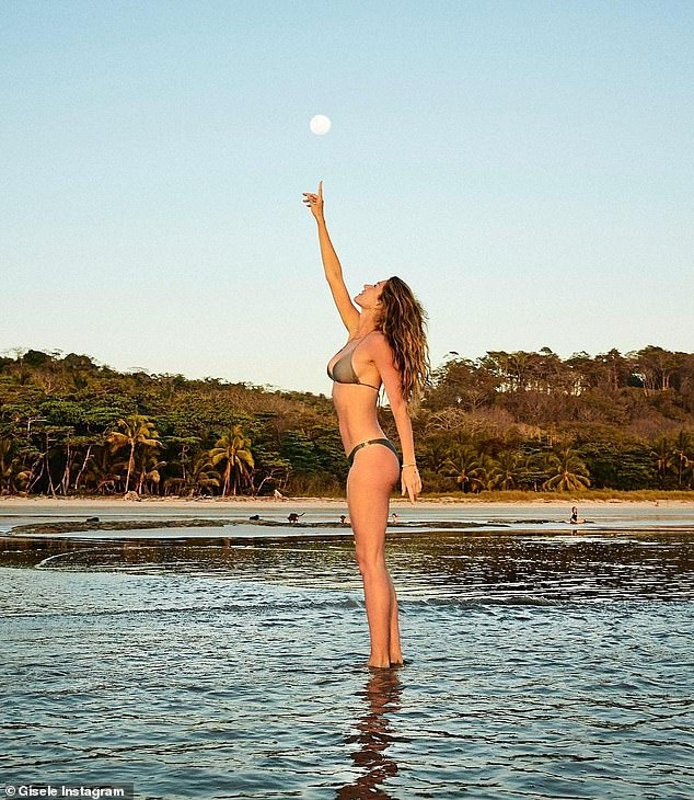 Bliss: Gisele Bundchen connected with the full moon while wearing a bikini on the beach for a stunning social share on Sunday night