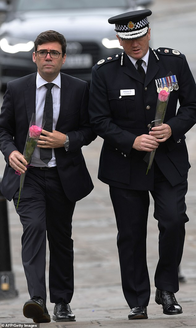 Mayor Andy Burnham, pictured with chief constable Hopkins in the aftermath of the Manchester Arena bombing, will retain political control of the ailing force