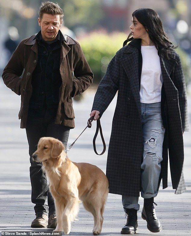 Jeremy Renner and Hailee Steinfeld play with furry friend as they shoot Hawkeye spin-off series