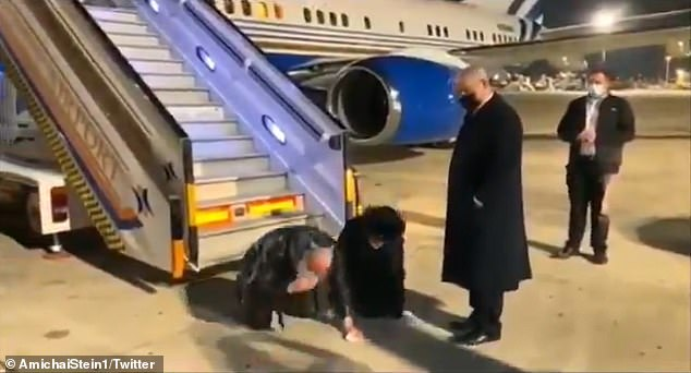 Jonathan Pollard kisses the ground as he lands in Israel and is met on the tarmac by Netanyahu