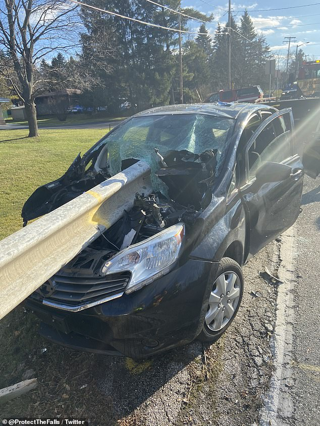 Metal crash barrier skewers completely through car in horror crash caused by texting driver