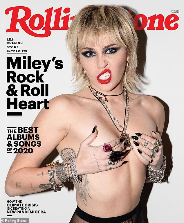 Miley Cyrus poses topless as she says she was 'not living a fairytale' when with Liam Hemsworth