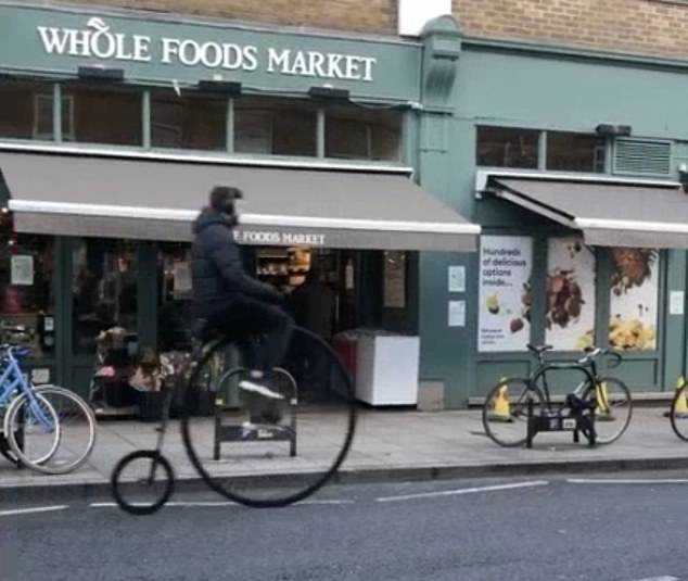 Moment penny farthing rider smashes into delivery van on north London street