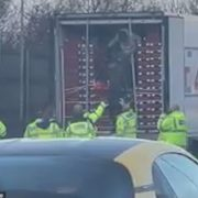 Moment police find 13 suspected migrants in the back of fruit lorry