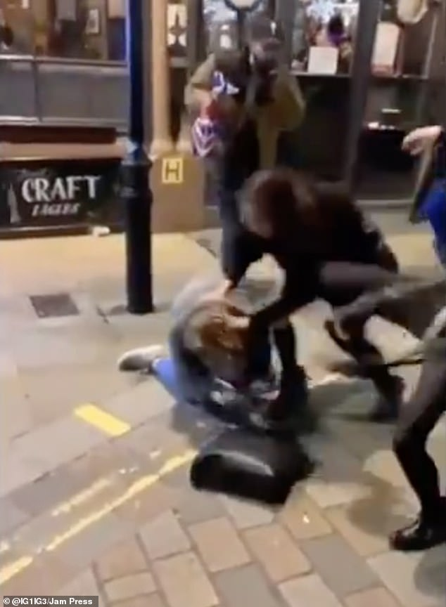 Moment three women trade punches and kicks in brutal brawl outside Oxford Street pub