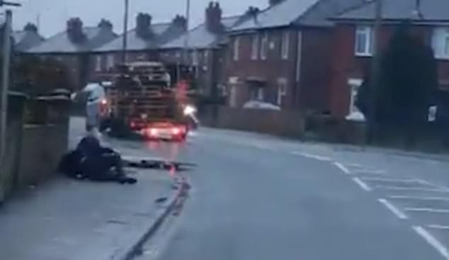Moment truck overloaded with wooden planks smashes pedestrian to the ground
