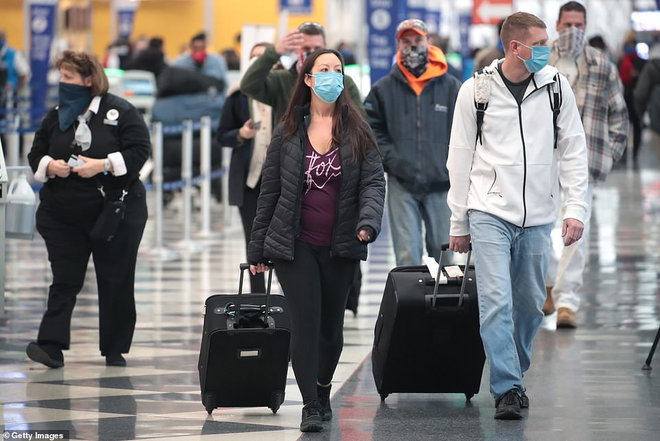 More than 5 million people passed through the nation's airport security checkpoints between Friday and Tuesday (Pictured:Travelers pass through O'Hare International Airport on December 23)