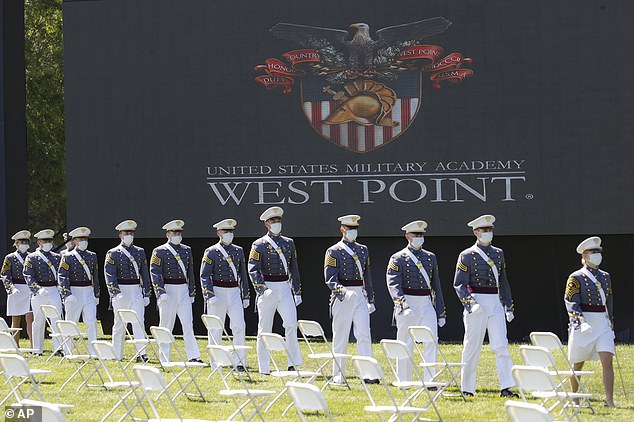 West Point is dealing with one of the worst academic cheating scandals in school history. Graduating cadets above wear face masks during commencement ceremonies on June 13