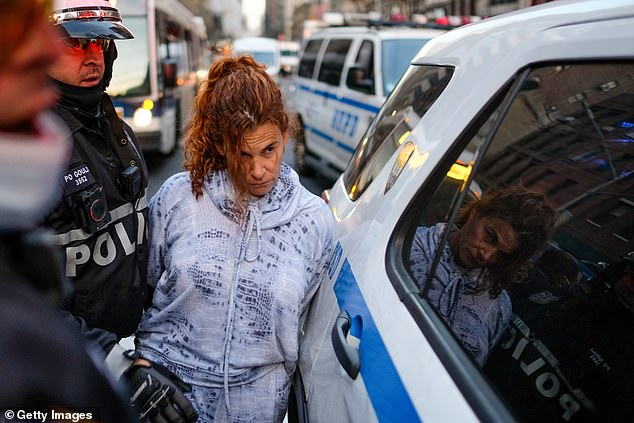 NYC woman, 52, is charged after plowing her BMW into crowd of protesters leaving six injured