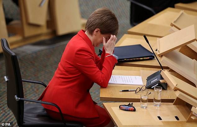 Nicola Sturgeon apologises after being spotted in a pub without wearing a face mask