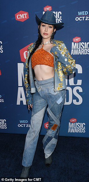 Noah Cyrus apologizes for using a racist remark to defend Harry Styles amid Candace Owens row