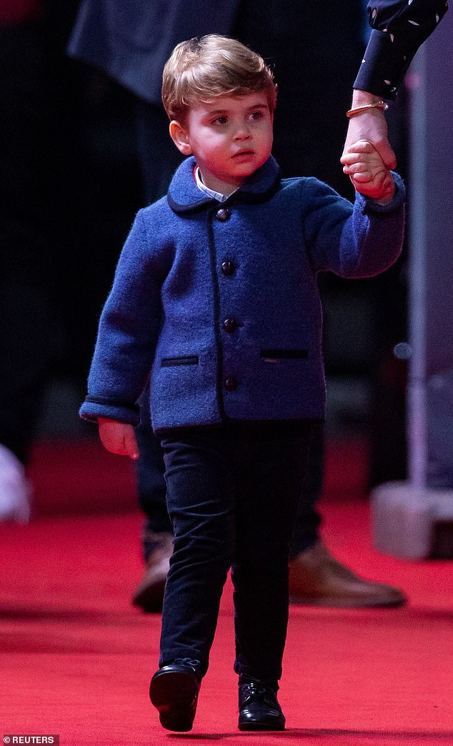 Prince Louis dons eye-catching blue felt jacket on family trip to West End pantomime…