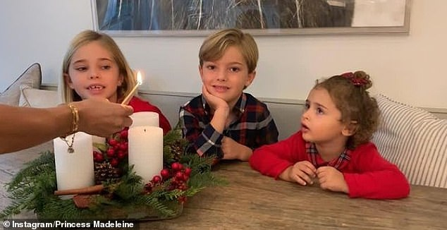 Princess Madeleine of Sweden, 38, has shared a rare family photograph of her children Leonore, six, Nicolas, five, and Adrienne, two, dressed in matching tartan outfits as they marked the start of the festive season