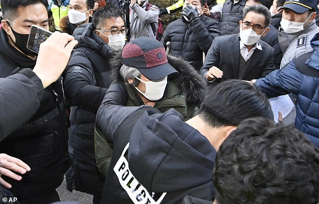 Protesters throw eggs and shout insults at South Korea's most notorious paedophile Cho Doo-soon
