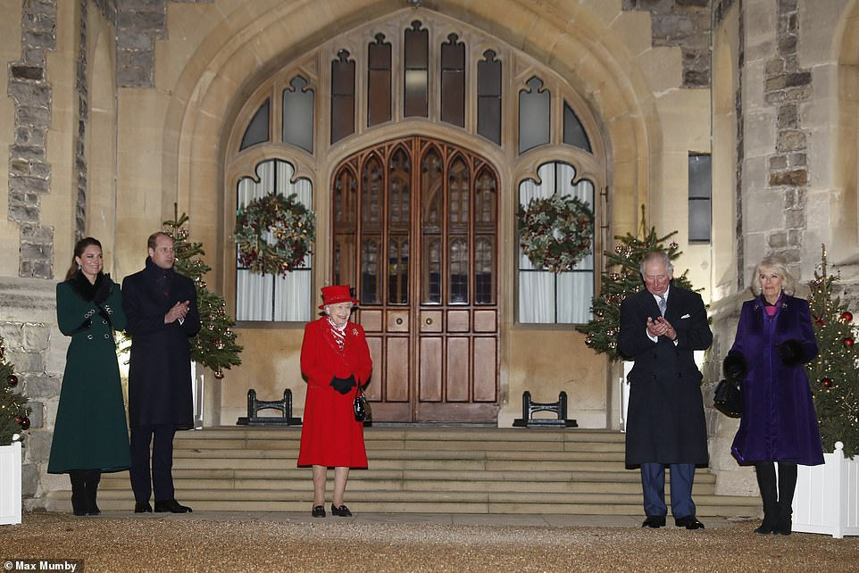 Queen is all smiles as Kate and William arrive back at Windsor