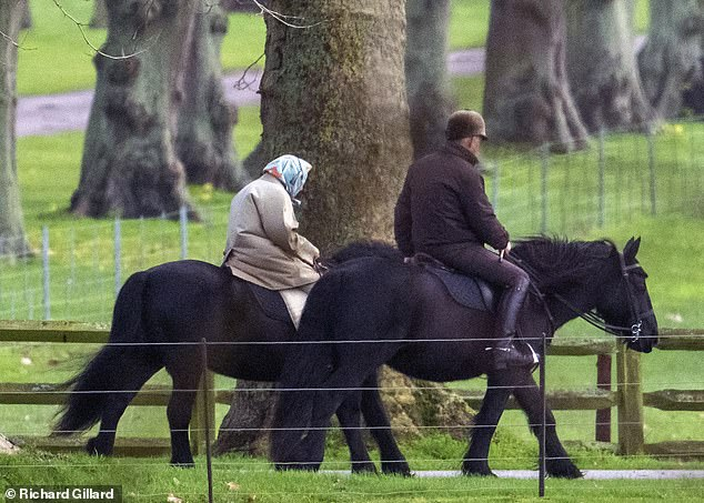 Queen wraps up warm for a horse ride around grounds of Windsor Castle