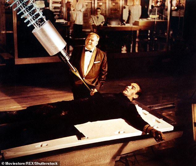 Given that the premiere of the latest Bond movie has been postponed because of corona, perhaps Dishi Rishi could bung Pinewood a few hundred million quid to come up with a hybrid homage to the original. Pictured: The famous laser beam scene in Goldfinger