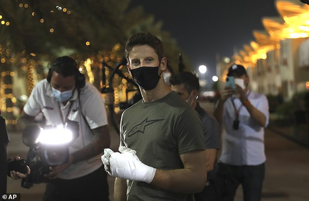 Romain Grosjean returns to the scene of his horror crash as he walk arounds Bahrain circuit