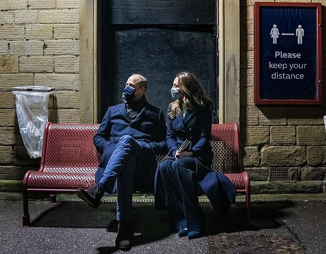 Taking station: Wills and Kate shiver on the Batley platform in West Yorkshire during their second day of a three-day tour across the country