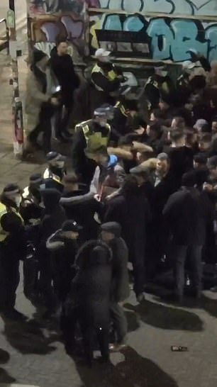 Seven people are arrested as police break up mass gathering