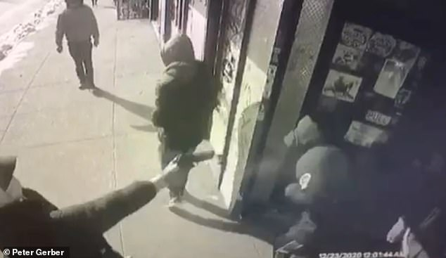 Pictured: Surveillance video captured the moment of the shooting at the deli