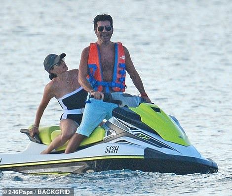 Simon Cowell proves he's on the road to recovery as he rides a jet ski in Barbados