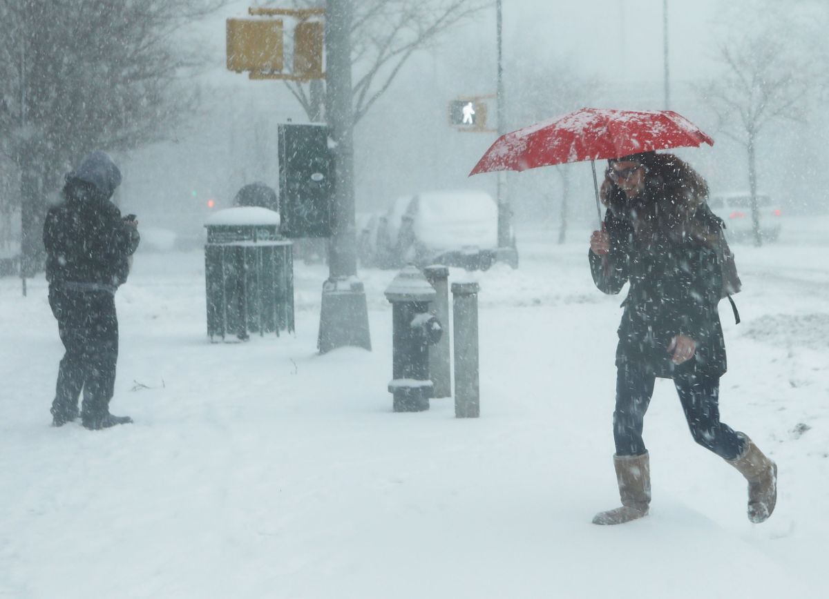 Snowstorm Leaves Up to One Foot of Snow in Areas of Cleveland, Ohio, and Over 100,000 Without Power   The State