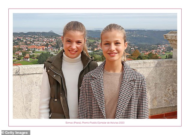 Feliz navidad! Princess Leonor, 15, pictured right, and Infanta Sofía, 13, don casual attire for the photo the Spanish royal family has chosen for their annual Christmas card