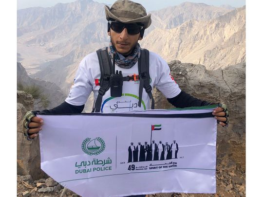 UAE National Day 2020: Dubai Policeman raises 'Spirit of the Union' banner on Ras Al Khaimah's Jebel Jais