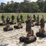 US Marines practice their shooting on human-like autonomous robots which fall over when 'killed'