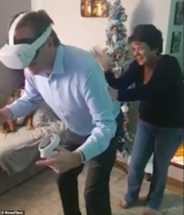 Vertigo sufferer has his family in stitches as he takes a virtual reality fairground ride
