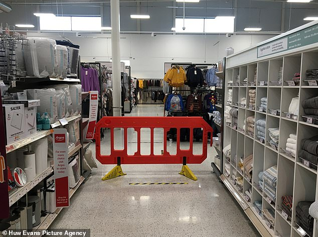 Pictures today emerged of Sainsbury's in Pontypridd which blocked off non-essential sections of the store using large red barricades (pictured)