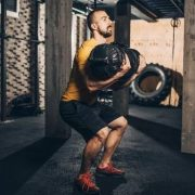 Workout with a sandbag to build muscles and gain strength